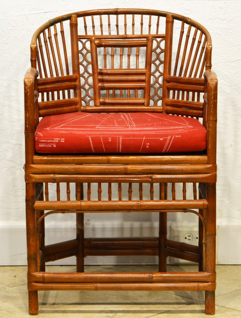 Rising on six legs this intricately crafted iconic armchair with cane seats and Ralph Lauren fabric cushion features a bamboo frame and Chinese themed bamboo open work inspired by Chippendale design, 20th century.