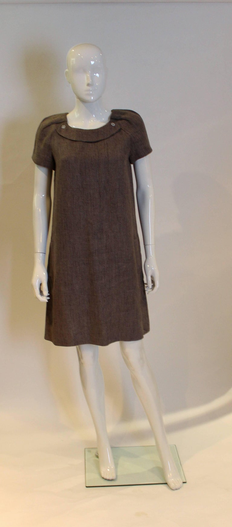 A great little black dress for Spring/Summer by Chloe. In a cotton /linen mix and fully lined, this dress has a round neck, short sleeves and two pockets. It opens with a beautifuly hidded zip at the back.