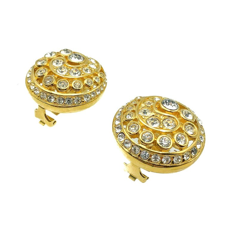 Vintage Dior Crystal Swirl Earrings. Crafted in gold plated metal and set with crystal chatons in a graduating swirl. In very good vintage condition. Signed. Approx. 2.7cms. A glamourous pair of earrings from the House of Dior that will undoubtedly