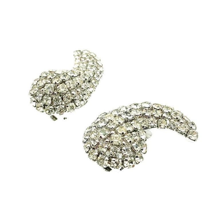 A pair of exquisite and super stylish Vintage Dior Wing Earrings. Featuring claw set paste chatons in a wing or apostrophe style design. Crafted in rhodium plated metal. Very good vintage condition, signed and dated, approx. 3cms. A super stylish