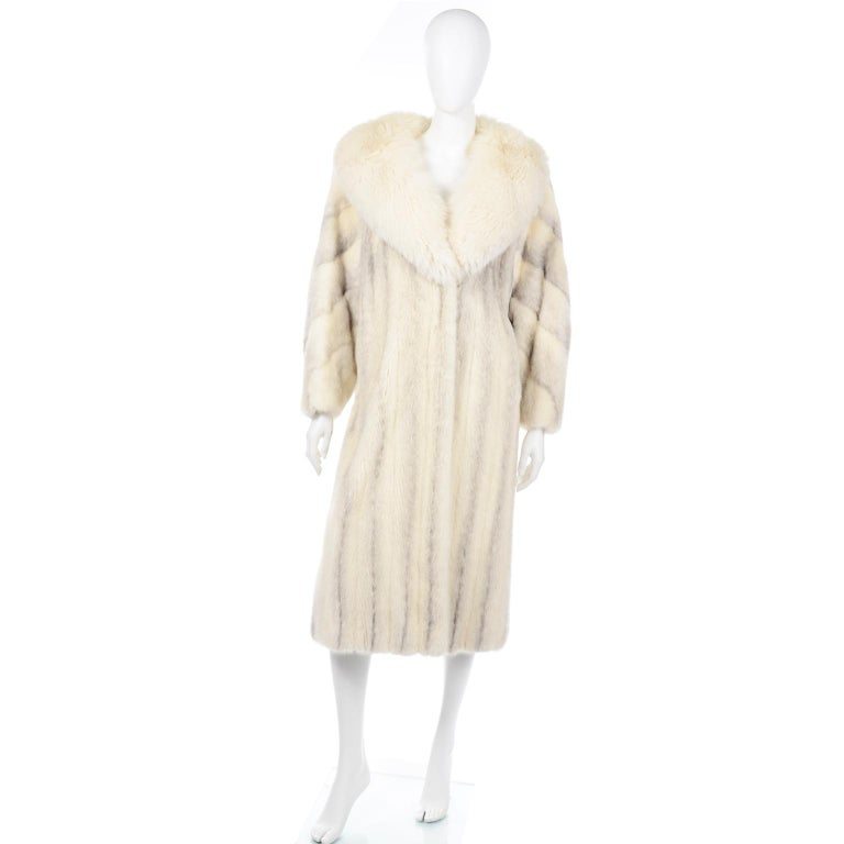 This incredible vintage Christian Dior white mink coat has a white fox fur shawl collar and side slit pockets. Luxuriously soft and comfortable, the waist can be cinched with an inner waist tie, The coat has the Christian Dior Fourrure label, and a