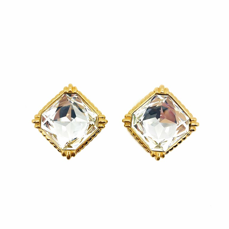 Truly stunning Vintage Dior Crystal Clips from the 1980s. Featuring solid, high quality gold plated metal mounts set with very large Swarovski Crystal Octagon headlight crystals. These crystals are simply the very best of Swarovski with their