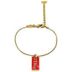 Vintage Christian Dior Gold & Red Enamel Logo Tag Bracelet 1990s