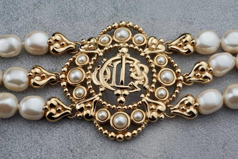 Vintage CHRISTIAN DIOR Logo Insignia Medallion Tiered Pearl Choker Necklace  MEASUREMENTS: Height: 2.16 inches (5.5 cm) Wearable Length: 13.78 inches to 15.35 inches (35 cm to 39 cm)  FEATURES: - 100% Authentic CHRISTIAN DIOR. - Dior insignia/ logo