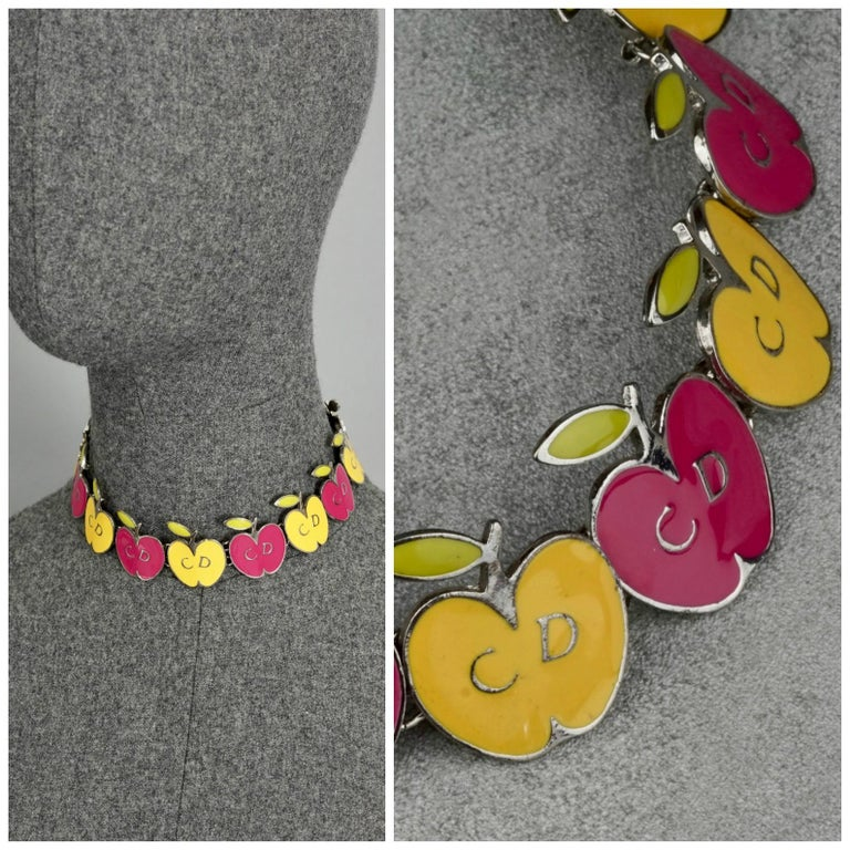 Vintage CHRISTIAN DIOR Logo Pop Enamel Apple Necklace  Measurements: Height: 1.26 inches (3.2 cm) Wearable Length: 12.79 inches to 14.56 inches (32.5 cm to 37 cm)  Features: - 100% Authentic CHRISTIAN DIOR. - Pop colour enamelled apples in pink,