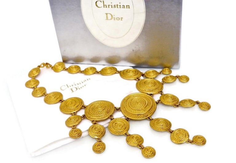 Vintage Christian Dior Mogul Braided Disc Logo Necklace  Measurements: Height: 4 6/8 inches (center part) Wearable Length: 17 inches  Features: - 100% Authentic CHRISTIAN DIOR. - Cascading discs with C logo at the center. - Braided pattern. - Fold