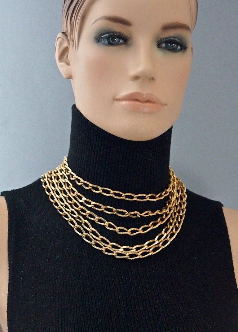 Vintage CHRISTIAN DIOR Multi Strand Chain Necklace  Measurements: Chain drop at the centre: 3.93 inches (10 cm) Wearable Length: 15.15 inches (38.5 cm)  Features: - 100% Authentic CHRISTIAN DIOR. - 5 layers/ strands of textured chain. - Signed CHR