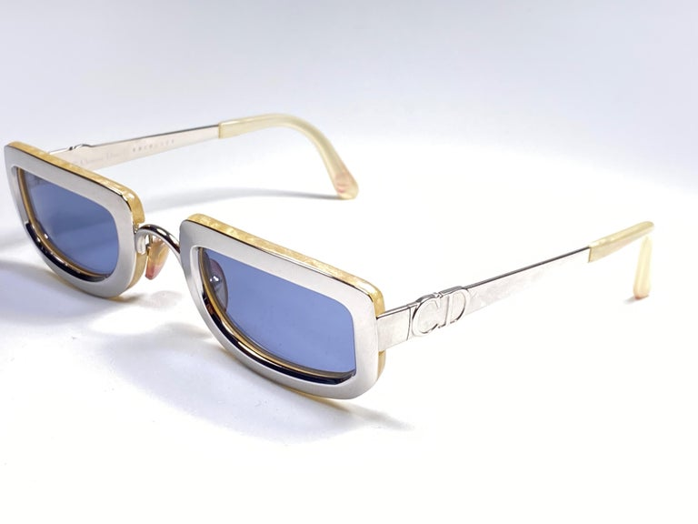 Vintage Christian Dior rectangular frame sporting grey lenses. Mother of pearl like inside adorns.  Made in Germany.   Produced and design in 1990's.  This piece could show minor sign of wear due to storage.