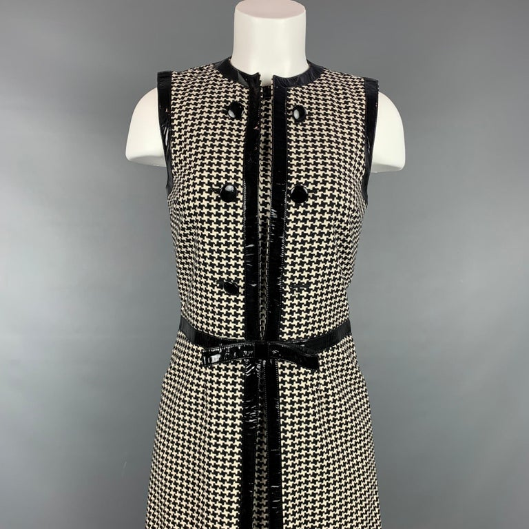 Vintage CHRISTIAN DIOR cocktail dress comes in a black & cream houndstooth wool / polyester with a slip liner featuring a bow detail, patent leather trim, collarless, front buttons, and a back zipper closure. Made in Italy.  Good Pre-Owned