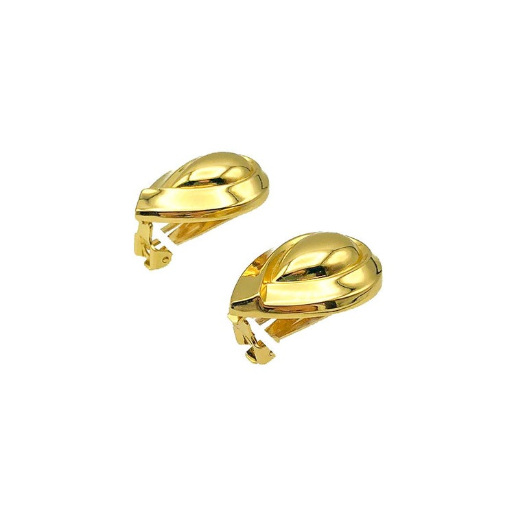 Vintage Dior Teardrop Earrings. Crafted in gold plated metal. In very good vintage condition. Signed. Approx. 3cms. The perfect go to earring that will become a firm style staple, morning till night.  Established in 2016 and based in the heart of