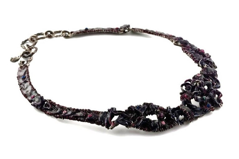Vintage CHRISTIAN LACROIX Brutalist Enamel Rhinestones Choker Necklace  Measurements: Height: 1 4/8 inches  Features: - 100% Authentic CHRISTIAN LACROIX. - Rigid choker in brutalist pattern with purple and violet enamel - Embellished with