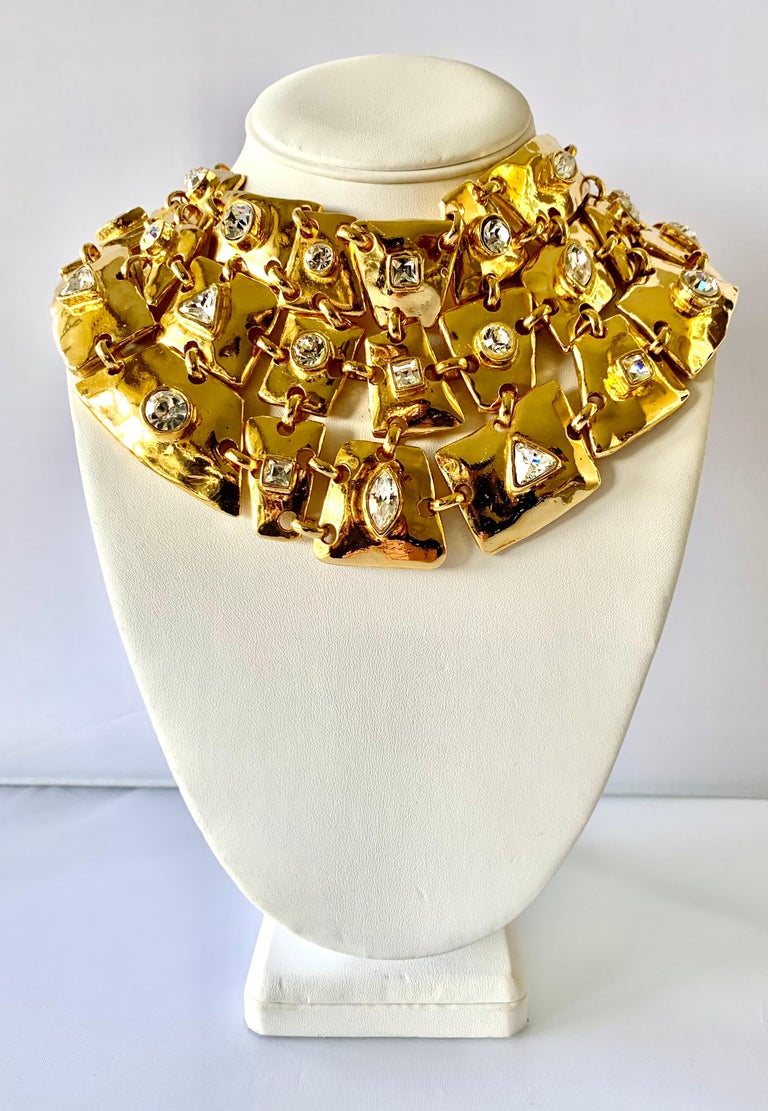 Vintage runway Christian Lacroix necklace comprised out of articulated gilt metal segment adorned with large faceted diamante rhinestones in the center. The articulated plates allow the necklace to sit perfectly on the neck and chest. Signed
