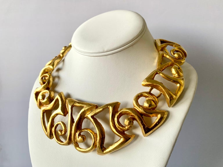 Vintage Christian Lacroix articulated gold-tone chunky statement necklace featuring a contemporary scroll tribal design - made in Paris circa 1990s.