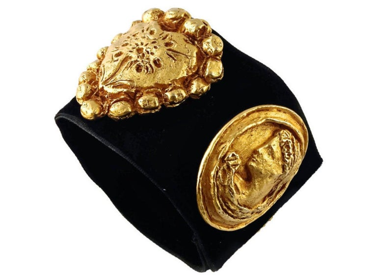 Vintage CHRISTIAN LACROIX Iconic Roman Heart Medallion Velvet Cuff  Measurements: Height: 2 1/8 inches Width: 6 6/8 inches to 7 1/8 inches  Features: - 100% Authentic CHRISTIAN LACROIX. - Raised and textured Lacroix emblems: star meddalion, female