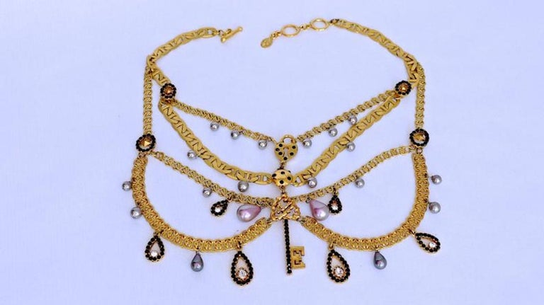 Vintage CHRISTIAN LACROIX Tiered Multi Charm Collar Necklace  Measurements: Wearable Length: 15.5 inches to 16.5 inches Height: 5 inches  Features: - 100% Authentic CHRISTIAN LACROIX. - 4 Tiered of alternating 2 styles of chain. - Variety of charms