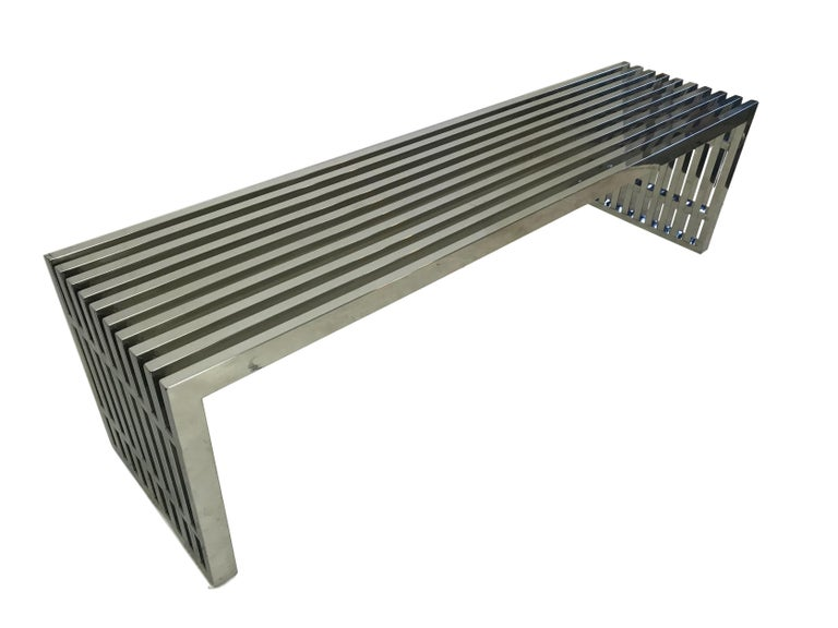 This is a vintage chrome slat bench or coffee table in the manner of Milo Baughman, circa 1970.