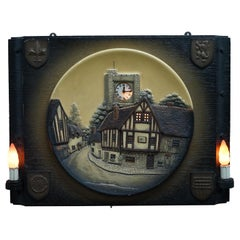 VINTAGE CIRCA 1950's WALL HANGING CLOCK WITH LAMPS DEPICTING A VILLAGE SCENE
