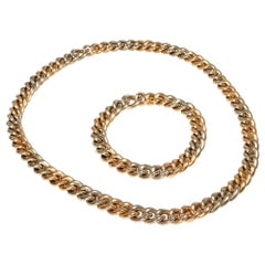 Vintage circa 1981, Pomellato 18 Karat Two-Tone Gold Necklace Two Bracelets Set
