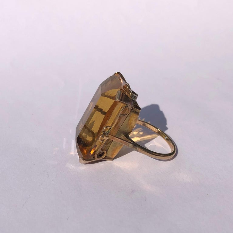 The rich coloured citrine stone is held by a very delicate claw at each corner of the stone. The rings modelled in 9ct gold and the setting and ring is a very simple design.   Ring Size: P or 7 3/4 Stone Dimensions: 25mm x 17mm  Height Off Finger: