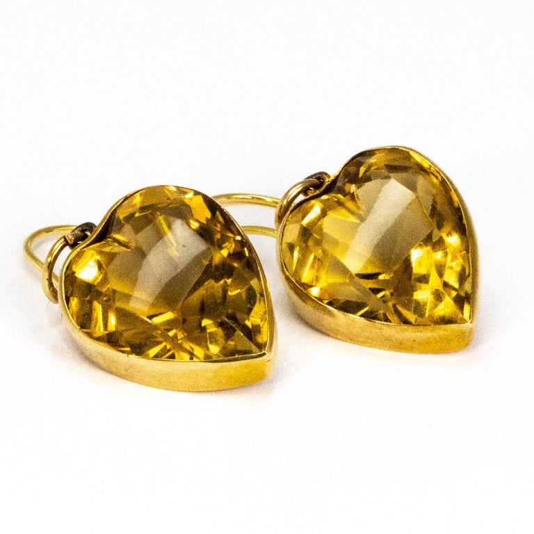 These gorgeous drop earrings feature a gorgeous bright citrine stone which is in the shape of a heart. The stones are attached using a shepherds hook.  Stone Dimensions: 14.5 x 17mm
