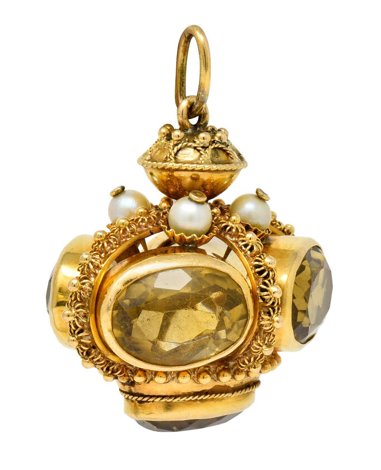Designed as a crown-like form with four curved arches; decorated throughout by caged florals, polished gold beads, and a draped twisted rope motif  Featuring five oval cut citrine, bezel set, measuring approximately 15.0 x 11.2 mm; transparent and a