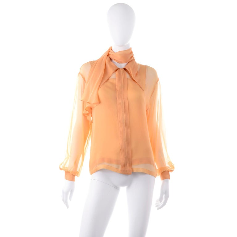 Claude Montana vintage blouses are always our favorites and this one is so beautiful with its sheer over blouse and solid camisole underneath.  This lovely 2 piece blouse was made in Italy. and is labeled a US size 10. and an Italian size 44. tag