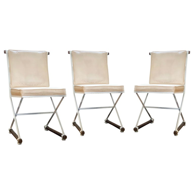 Wrought iron and oak Cleo Baldon white terra dining chair, midcentury, California, 1960s. Original leather (or leather-like) peachy cushions. White finish appears to be original and remains in good condition considering age. Priced per chair, 3