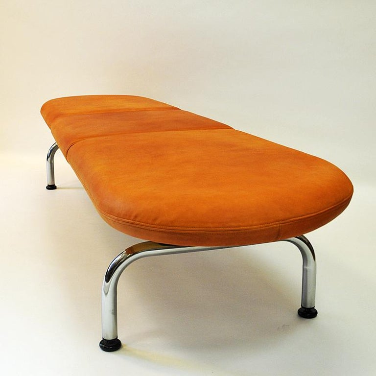 Marvelous sofa bench cobra designed by Johannes Foersom & Peter Hiort-Lorenzen for Erik Jørgensen Møbelfabrik in 1986 and then manufactured in the 1980s, Denmark. Cushions with beautiful cognac leather and a solid stainless steel frame underneath.