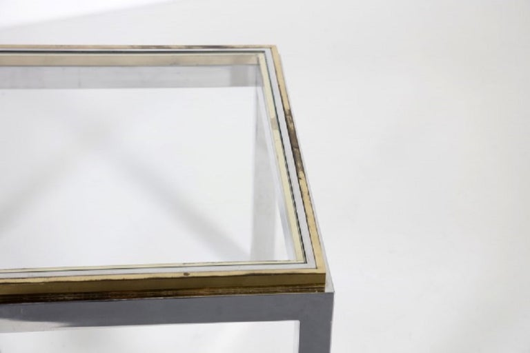 Vintage coffee table is an original design work realized in the 1970s and inspired by the work of Willy Rizzo (Naples, 1928 - Paris, 2013).   Original glass, steal and brass.   Excellent conditions.   Create an inviting atmosphere with this
