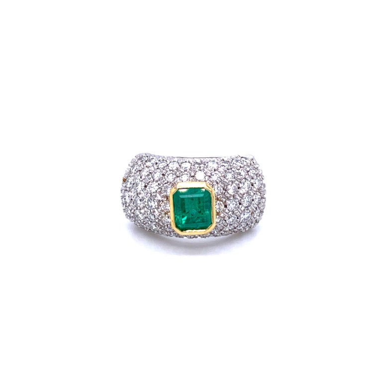 A beautiful emerald ring dated 1960, handmade in Italy in 18k white Gold showcasing a Natural Colombian emerald cut Emerald in the center weighing approx. 1.20 carat and surrounded by 2.00 carat of diamonds graded G color Vvs clarity pave