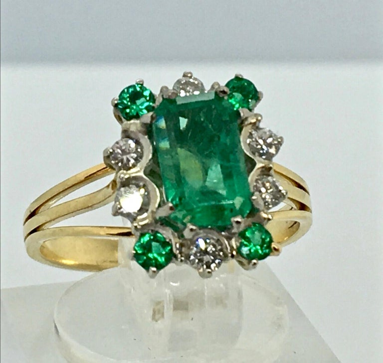 Vintage Stunning Colombian Emerald Solitaire Ring with Accents   Colombian Emerald and Diamond Ring prong set in White and Yellow solid 18K gold. Feature one Genuine and natural Colombian Emerald (Emerald cut) weighing 2.50ct/ Vivid Medium Green.