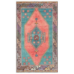 Vintage Colorful Rug in Green and Coral Tones with Stretched Tribal Medallion