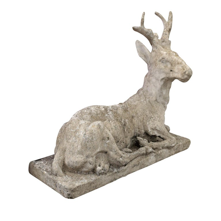 Vintage concrete stag sculpture, a stately depiction of a noble stag at rest, hand-modeled by an anonymous master artist in France using concrete during the early 20th century.