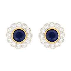 Vintage Convertible 0.50 Carat Sapphire and Diamond Halo Earrings, circa 1980s
