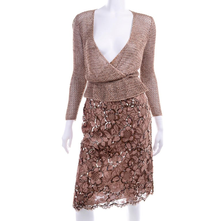 This vintage ensemble includes a gorgeous copper lace skirt with sequins sewn in a decorative floral pattern and a soft copper V neck crochet knit surplice top with an elastic waistband and a thin knit belt to accentuate waist. The skirt is a pencil
