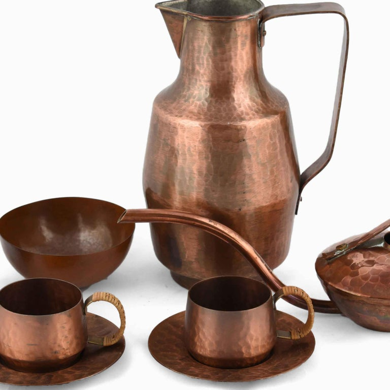 Mixed Copper Lot is an original group of objects realized in the second half of the 20th century.  The group includes 6 objects: one Art Deco cup, one donut pitcher (realized by Eugen Zint), one can realized by VED Kunstschmiede Neuruppin, two