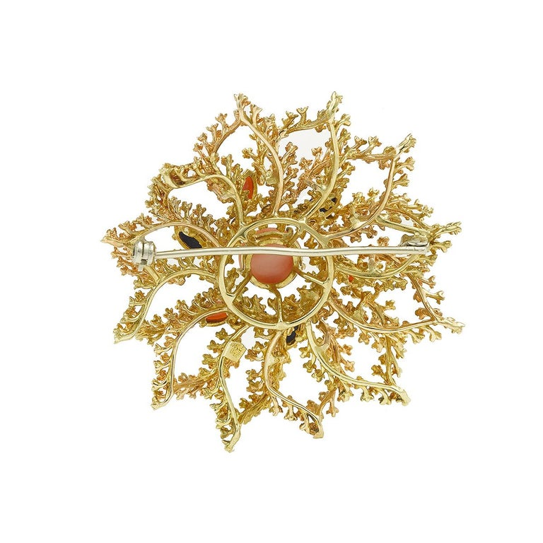 Stunning 18k yellow gold sea urchin brooch, decorated with a round coral.  The main stone is surrounded by three lapis lazuli and three coral marquises.  Brooch measures 49 mm (1.9 inche) in diameter and weights 23 grams.   Good condition  Italian