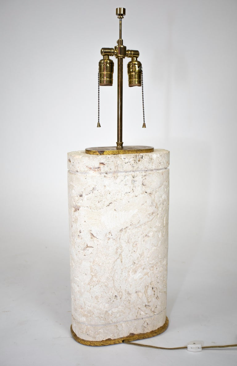 A carved oval coral stone lamp with gold-leafed hardware. Superior quality manufacture.