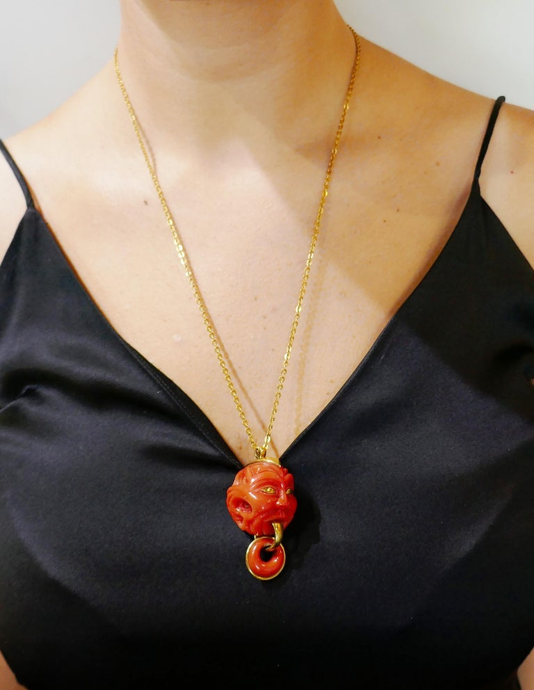 Fun and unusual coral pendant that is definitely a conversational piece.  The pendant is made of carved Mediterranean coral and 14 karat (tested) yellow gold. It measures 2 x 1 x 1-1/8 inches (5 x 2.5 x 2.8 cm) with the bail. The chain is made of 18