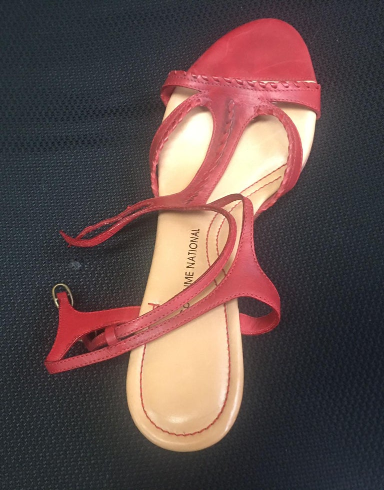 Enjoy the comfortable and professional look of Costume National. Red Leather with braided trim wedge heel Sandals; Leather lined; 3.25 inch wedge heel; Size 40; Made in Italy. Fabulous condition; gently worn; minimal bottom wear on soles. A great