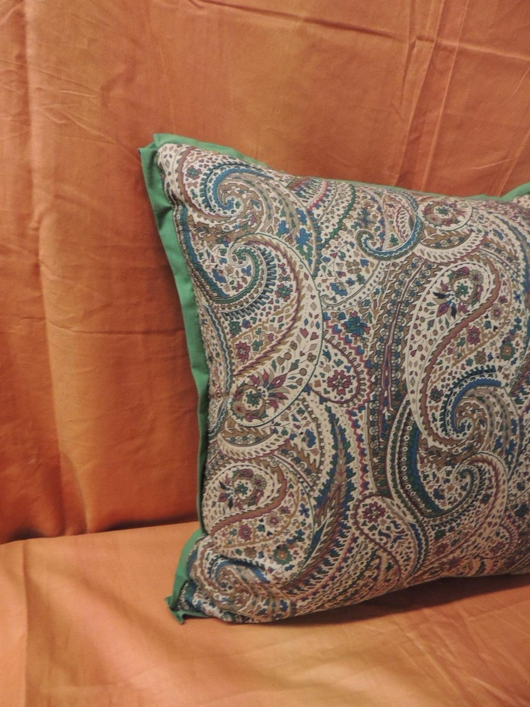 Printed paisley pillow with embellished with a hunter green flat ATG custom trim and moss green linen backing. Decorative vintage textile pillow in shades of hunter green, moss green red, camel, blue and tan. Vintage decorative pillow handcrafted