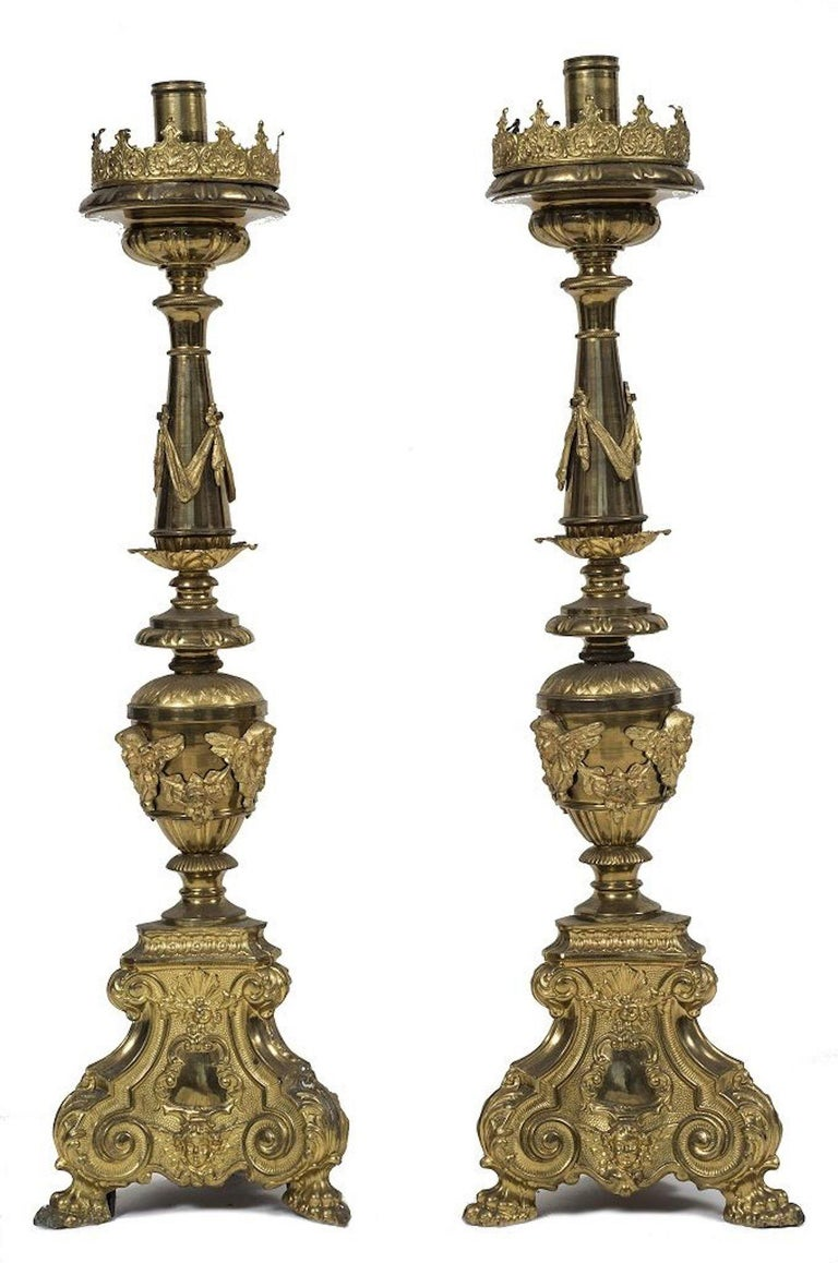 Couple of big candlesticks is a very refined decorative object in brass and gilded metal.