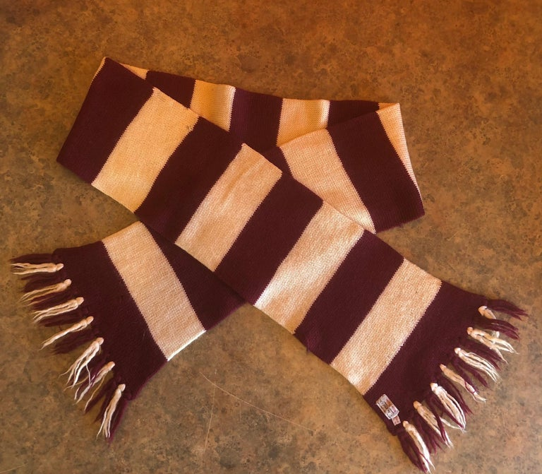 Vintage crimson and white Harvard University striped scarf / muffler by J. August Company, Harvard Square, circa 1950s. The muffler is 100% wool and was handcrafted in England. The piece is super hard to find and is in very good overall condition