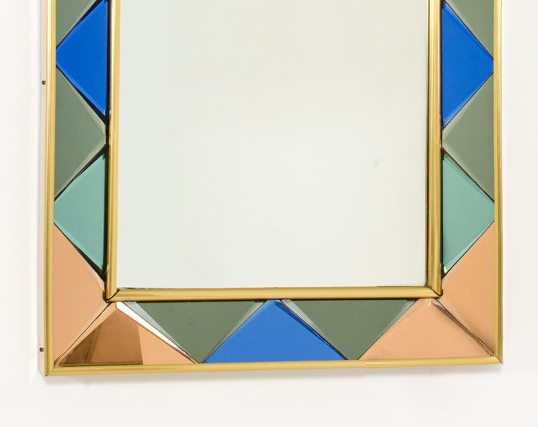 Cristal Art mirror 1960s. Frame with raw plugs made in colored glasses. Excellent conditions.