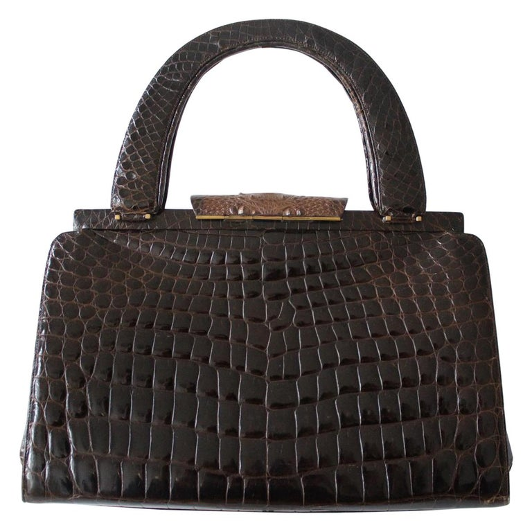 Fantastic vintage bag Real crocodile Wonderful mix of polished and opaque relief Different tones of brown Two handles Internal zip pocket Additional  four pockets Cm 37 x 22 x 12 (14.5 x 8.66 x 54.72 inches) Good conditions considering the