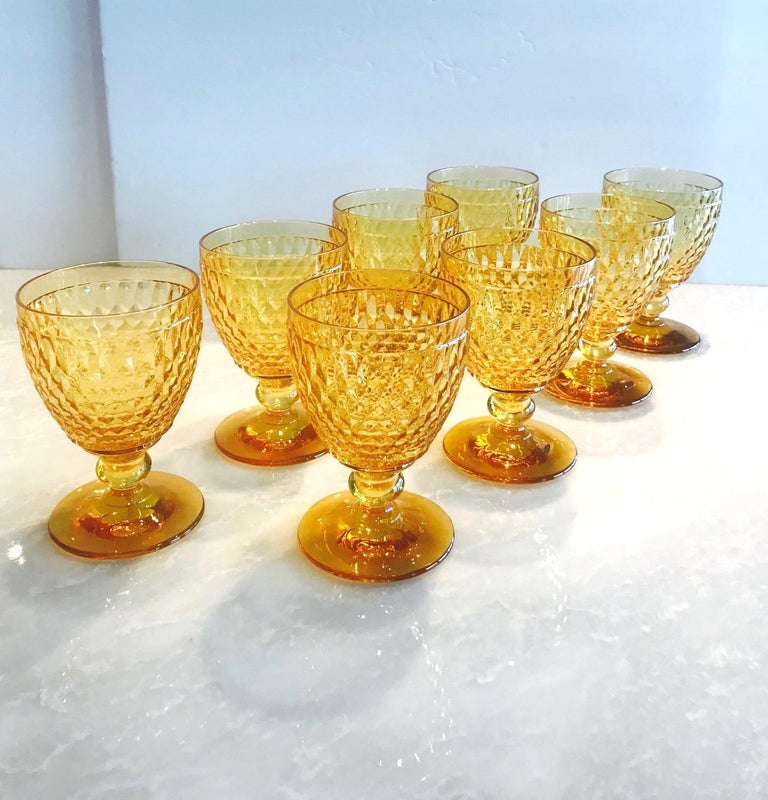 Set of eight luxury crystal goblets from Villeroy & Boch's Boston series. The stemware glasses are comprised of hobnail crystal with classic diamond patterns and deliberate short stems. In gorgeous amber colored crystal, making them a unique and