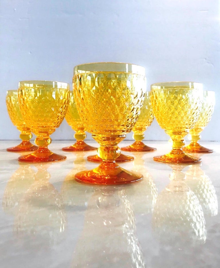 Set of eight luxury crystal claret wine glasses from Villeroy & Boch's Boston series. The stemware glasses are comprised of hobnail crystal with Classic diamond patterns and deliberate short stems. In gorgeous amber colored crystal, making them a