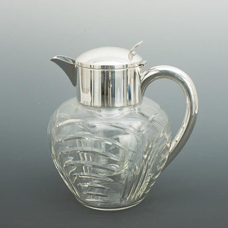 Vintage cut glass lemonade jug with cooler. A very nice large lemonade jug with original internal cooling insert, this is the ideal way to keep your beverages chilled. The glass insert is filled with ice and put in place thus cooling the liquid