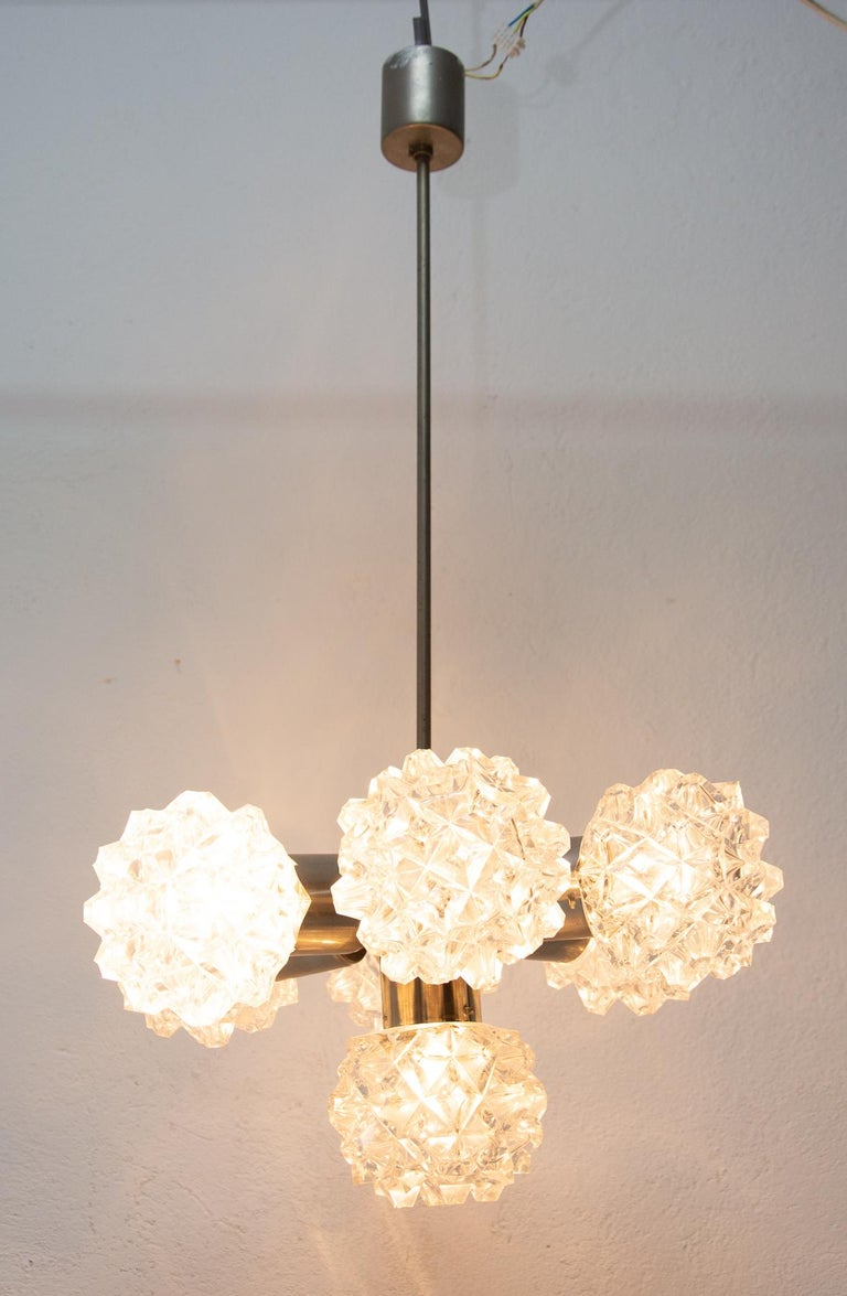 Czechoslovak cut glass and chrome-plated ceiling light, made in the former Czechoslovakia for Kamenický Šenov in the 1970s. It features chrome steel structure and seven cut glass lampshades. The pendant is in very good condition. Newly wired.