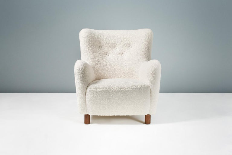 Danish cabinetmaker   Lounge chair, 1954  Armchair in the manner of Fritz Hansen, produced in Denmark and distributed by FDB Mobler. Stained beech legs with new cotton-wool blend boucle wool fabric upholstery.   Measures: H 73cm / D 68cm / W